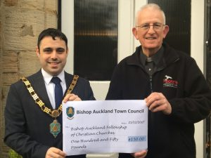 Mayor Adam Zair presenting a cheque for £150 to Father Dennis Tindall, Bishop Auckland Fellowship of Christian Churches