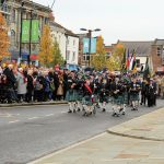 Bishop Auckland and District Pipes and Drums parading into Bishop Auckland Market Place